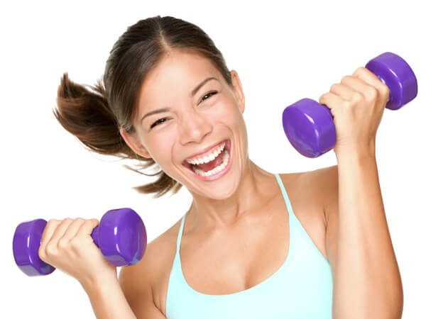 Happy fitness woman lifting dumbbells for Fish oil weight lifting